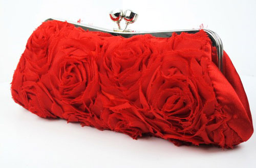 red rose covered clutch bag